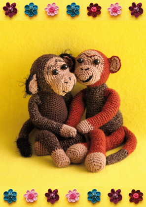 Two monkies on a yellow background