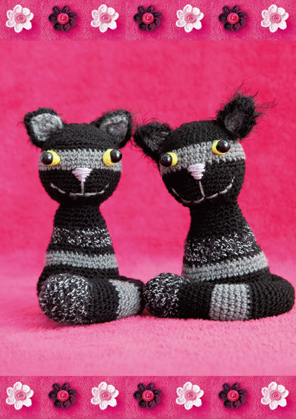 Two striped cats on pink